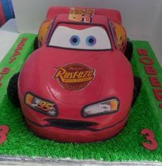 Lightning McQueen Cars cake - all cake covered with fondant and decorated with edible print stickers. Car about nearly 40cm in length