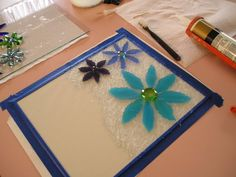 """Good tutorial...  """"flowers and doo-hickys are glass bits and half-marbles. On the panes, clear GE II 100% Silicone Caulk (indoor/outdoor for window & door) was used. Personal choice. I think any clear caulk for exterior use would do.  I used an old toothbrush to stipple it on the glass, then pressed my glass bits and marbles down on top of it. I did a small section at a time."""""""