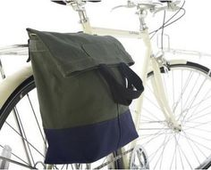 Linus Bike Sac Bag byLinus Bike  Made of water-resistant waxed canvas and a coated base it is extremely durable. It closes with a magnetic snap and with a simple hook design the Sac Bag attaches easily to your rack or with the strap you can throw it over your shoulder.  D-ring adds the option of locking bag to rack.