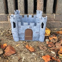 Give your finger puppets a place to play and live with this adorable felt castle.    It is approximately 8 tall, 9.5 wide, and 8 deep. The door