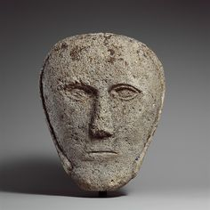 Head of a Man Wearing a Cap or Helmet Date: possibly 2nd–3rd century Geography: Made in probably British Isles Culture: Celtic Medium: Fossiliferous limestone