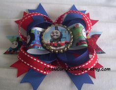 Thomas Hair bows Girls Bottle Cap. Maybe it being Thomas would encourage her to keep the damn bow on!