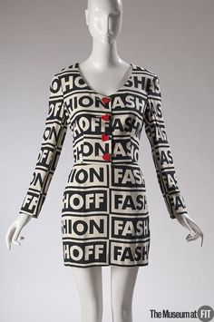 Woman's suit | Franco Moschino (Italian, 1950-1994) | Italy, 1990 | Black and off-white rayon, red wood buttons | Franco Moschino was an iconoclast who used humor and incongruous imagery to make philosophical points. Many of his fashions and advertisements provided commentary on the fashion industry. On this suit, Moschino seems to question fashion itself, with graphic lettering that reads 'fashion' and 'fashioff' | The Museum at FIT, New York