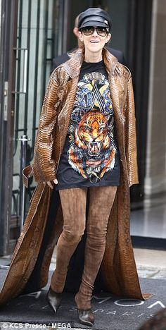 Striking: Celine Dion commanded attention as she exited the Royal Monceau Raffles Paris on...