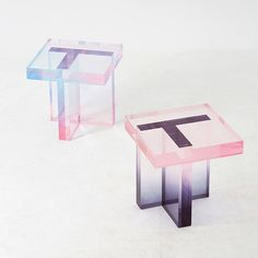 By using dyed acrylic resin Korean designer Saerom Yoon has conceived a series of tables that seem made of crystal.