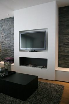 Bump out for TV and fireplace.  Benches for storage on side.  Stone wall on sides.