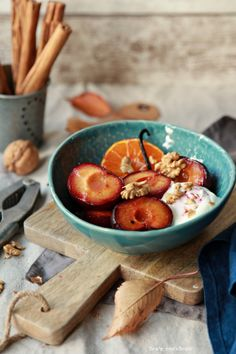 Plums baked with cinnamon,vanilla, oranges.