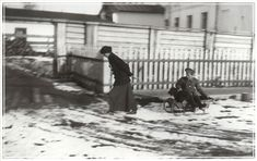 Olga takes Alexsei and dog Joy for ride on sled in snow at Tobolsk 1917.