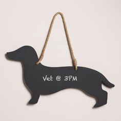 Elevate the charm of your kitchen with our whimsical wiener dog-shaped chalkboard hanging from a rustic, natural jute rope.