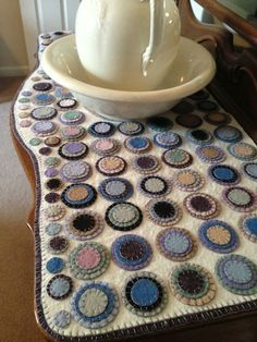 Handmade wool penny rug to fit my antique dresser. More