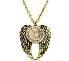 Heaven cent. Enlighten your look with this pretty pendant. Angel wings provide the perfect perch for a 24K gold-layered one-cent hummingbird coin from the Republic of Trinidad and Tobago. A rhinestone bezel adds a touch of shimmer, and it dangles from a goldtone chain. #QVCgifts #qvcgifts #QVC #coinjewelry #hummingbird