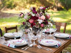 Bountiful red and green floral centerpiece | Christa Elyce Photography | see more on: http://burnettsboards.com/2014/09/americana-wedding-antlers/