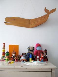 Apartment Therapy Post. Love all of the cool toys. Idea for kids room.