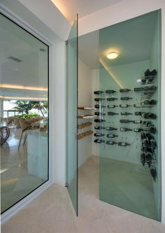 Modern Wine Cellar with High ceiling, limestone tile floors, flush light