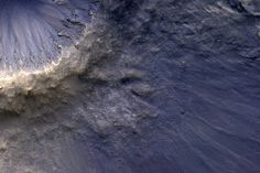 When an asteroid or other object impacts the surface of a planet, material that was originally beneath the surface is thrown up and out causing scenes like this image captured by NASA's Mars orbiter. Empire State Building, Mars Pictures, Astronomy Pictures, Blues, Nasa Missions, Mission To Mars, Space Photos, Space And Astronomy, Astrophysics
