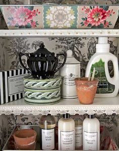 Line cabinet interiors with wallpaper and edge shelves in trim for a cheerful greeting every time you open the door. Floral-patterned trays corral laundry and sewing supplies.   - CountryLiving.com
