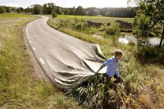 Image conceived and created by Swedish photographer Erik Johannson. Working out of his studio in Berlin, he layers and retouches photos he has taken to achieve images that seem to be taken from dreams. Image: Erik Johansson: 'Go Your Own Road' (© Erik Johansson)