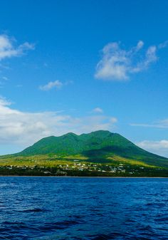 See the gorgeous green hills of St. Kitts. This Caribbean island is also home to golden beaches and even dormant volcanoes.
