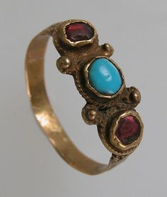 Finger Ring Date: 7th century Geography: Made in Northern France Culture: Frankish Medium: Gold, turquoise, glass paste Dimensions: Overall: 13/16 x 3/4 x 1/4 in. (2 x 1.9 x 0.7 cm) Classification: Metalwork-Gold Credit Line: Gift of J. Pierpont Morgan, 1917