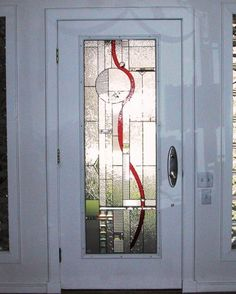 Full view door with red ribbon accent in geometric (Chandler) design, many textures of glass and bevels used