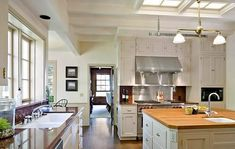 Traditional materials are what I keep radiating to........butcher block, white cabinets, --that is my range!!