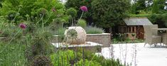 Andrea Newill offers a creative and practical garden design service throughout Berkshire, Hampshire, Oxfordshire, Wiltshire, Reading and Newbury. Sphere Water Feature, Aluminum Pergola, Contemporary Garden Design, Sloped Garden, Water Features, Hampshire, Service Design, Plants, Law School