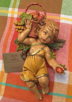 1990 E. SIMONELLI DEPOSE ITALY CHERUB WITH Basket of FRUIT Apple