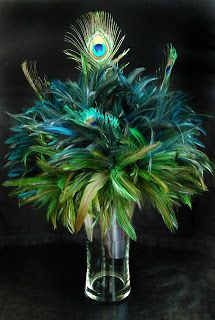 that would make an awesome eco-chic wedding bouquet! Wedding Flower | Wedding Candles | Wedding Decorating: Peacock Wedding Flowers | Peonies Wedding Flowers table decorations, peacock feathers, bridal bouquets, wedding decorations, wedding flowers, table centerpieces, peacock colors, mardi gras, wedding centerpieces