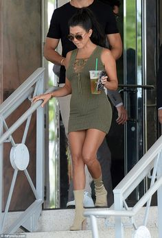 Her take: Kourtney modeled a fitted, ribbed dress complete with a V-neck, drawstring neckline
