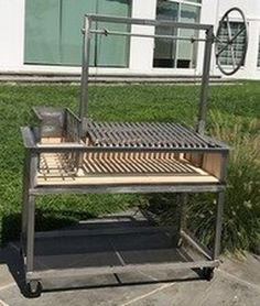 The Capicola is a Stainless Steel Argentine Grill for Wood or Charcoal Grilling with Side Brasero X X includes adjustable grill grate, slanted V-Grate, wheel and cart. Asado Grill, Argentine Grill, Argentinian Bbq, Bbq Equipment, Bbq Tongs, Diy Grill, Grilling Sides, Grill Grates, Grill Design
