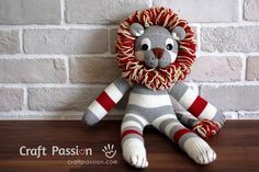 Sock Lion Tutorial.  Okay ... the socks are bought.  However, yarn is involved and he is flipping cute to boot.                                                                                                                                                     More