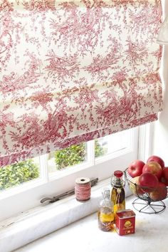 Bring red into a room with pattern florals and toile patterns, keep the rest of your interior neutral and add similar shades of pink with accessories throughout the room. Our Parisian Red Roman blind is perfect for this.