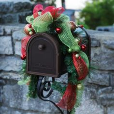 Style YOUR mailbox with our new Glitzy Red & Green Mailbox Swag! Interlaced with ribbons, this swag features shimmering red, green and gold ornaments that will give your welcome guests with holiday cheer!