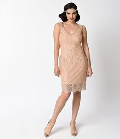 Hold still, darling. Dorothea needs to be photographed! A delightful 1920s inspired peach pink flapper dress from Unique Vintage, The Dorothea Flapper is a vintage style treasure that has us swooning. The delicate peach pink mesh overlays a soft and stret