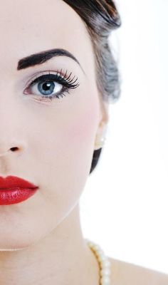 Barely there, yet bold eyes, and smokin' red lips!