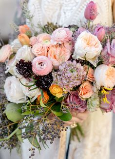 warm blush-hued spring ranunculus bouquet