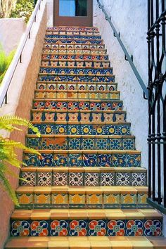 Tiled risers on staircases make them less of a chore to climb. Stairways, ideas, stair, home, house, decoration, decor, indoor, outdoor, staircase, stears, staiwell, railing, floors, apartment, loft, studio, interior, entryway, entry.