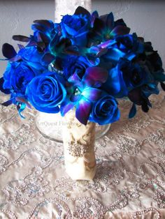 Blue roses and hand wired dendrobium orchids reception wedding flowers,  wedding decor, wedding flower centerpiece, wedding flower arrangement, add pic source on comment and we will update it. www.myfloweraffair.com can create this beautiful wedding flower look.