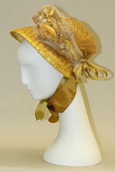 Yellow straw and silk bonnet, American, 1800-1810.