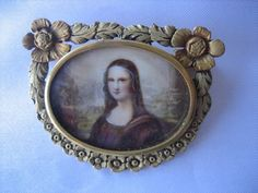 RARE ANTIQUE VICTORIAN HAND PAINTED MONA LISA WITH TROMBONE CLASP