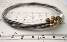 This sophisticated guitar string bracelet ($26). | 32 Impossibly Cute Pieces Of Jewelry For Music Lovers #GuitarStrings