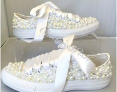 Classic White low rise converse with -Beautifully encrusted toes using pearls , lace, crystals and vintage brooches. - Fully embellished back-strips given a vintage feel with vintage brooches and pearls - Unique pearl and satin entwined laces.  The embellishment is more white in colour but ivory can be added on request to add a contrast. We also have a cream version under a different listing.  Perfect for a brides special day or a lucky bridesmaid! We can adjust anything you see here, we can…