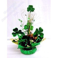 Foam Board Shamrock Cut Outs used in a centerpiece. Great for St Patrick's Day table decorations. www.awesomeevent.com