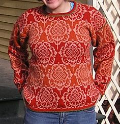 Summary: The sweater is knitted from the bottom up with picot edging hem. Armholes are steeked. Arms are knit in the round and sewn on. Pattern on page 140 of English edition.