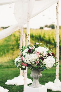 Birch Chuppah, urn arrangement, altar, vineyard wedding Niagara on the Lake