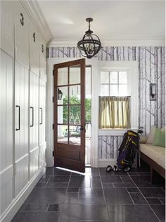 Bring the outdoors in with forest wallpaper in the foyer. Cool light adds interest too.