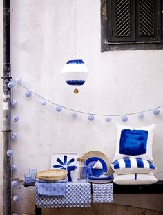 Keep a tight color palette, like with refreshing blues like these from @IKEAUSA, to incorporate multiple patterns without overwhelming your patio or deck, suggests @KhristianHowell. #sponsored