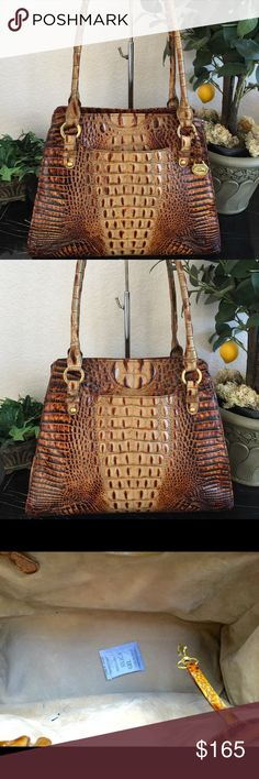 """🍂🍁BRAHMIN ANNETTA TOASTED ALMOND TOTE 🍂🍁 Rare Vtg Brahmin """"Annetta"""" in Toasted Almond.  A retired favorite! MSRP $415 Excellent condition w/a couple of pen marks inside near the pen loops. No outer corner wear or scuffs. Both sides ofthe exterior are slip pockets! Magnetic closure, Long Double handles will fit over shoulder! Plain suede-like lining w/2 zip pockets, 2 leather trimmed slip pockets. Original Brahmin dust bag and registration card included! 10.5""""wide top,tapers to…"""