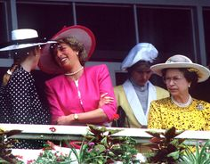 The Princess of Wales laughing with the Dutchess of York on the balcony of the royal box on Derby Day at Epsom Race Course, June 1987