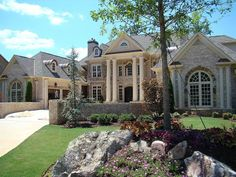<ul><li>This luxury home plan features a stately courtyard entry flanked by matching garages.</li><li>Grandeur is evident as you step into the two-story entry hall (see photo) with a dramatic curved stair.</li><li>Five fireplaces grace this design - Luxury House Plans, Dream House Plans, House Floor Plans, Architectural Design House Plans, Architecture Design, Creative Architecture, Courtyard Entry, Keeping Room, In Law Suite
